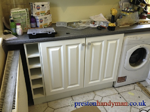 built in storage a kitchen base unit installed under a breakfast bar created some much needed storage the wine rack at the end is made to pull out easily to access the fuse